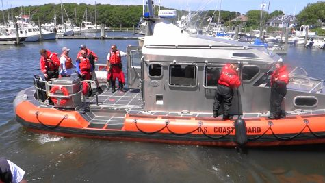 Barnstable County dive team divers depart with the Coast Guard from Saquatucket Harbor to search for a missing fisherman